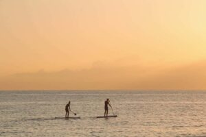 paddling with surfboards