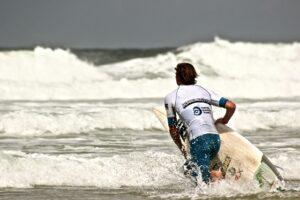 man preparing to surf