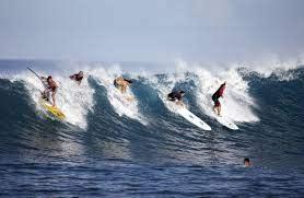 multiple men surfing