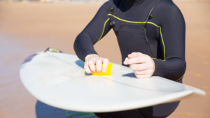 cleaning a surfboard