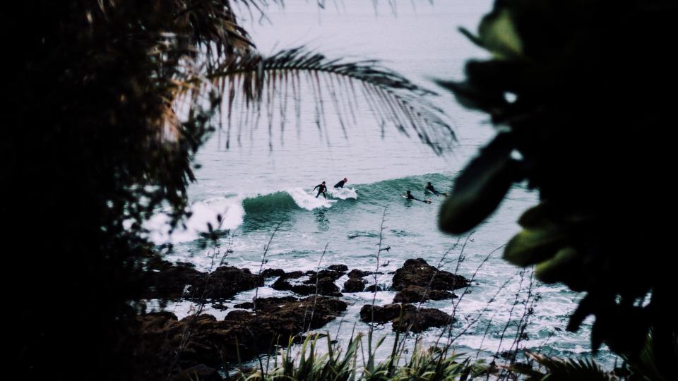Surfers in small waves